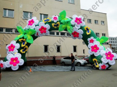 Inflatable arch decorated with inflatable flowers