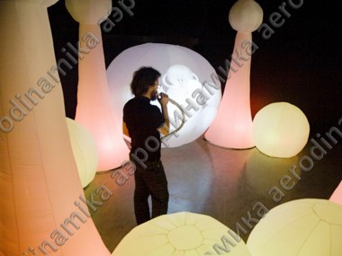 Stage decorated with inflatable spheres and cones