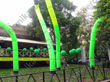 Café decorated with inflatable dancing tubes
