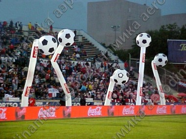 Sport event decorated with inflatable dancing tubes with soccer balls on the top