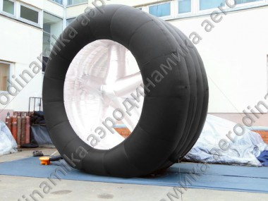 Inflatable wheel for replaceable banners