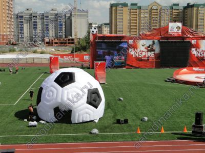 Soccer ball shaped inflatable dome