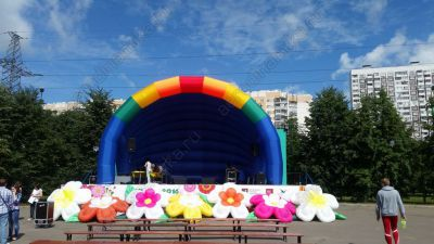 Inflatable stage cover and flower garland