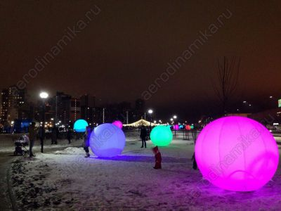 Inflatable balls with inner backlight as a square decoration